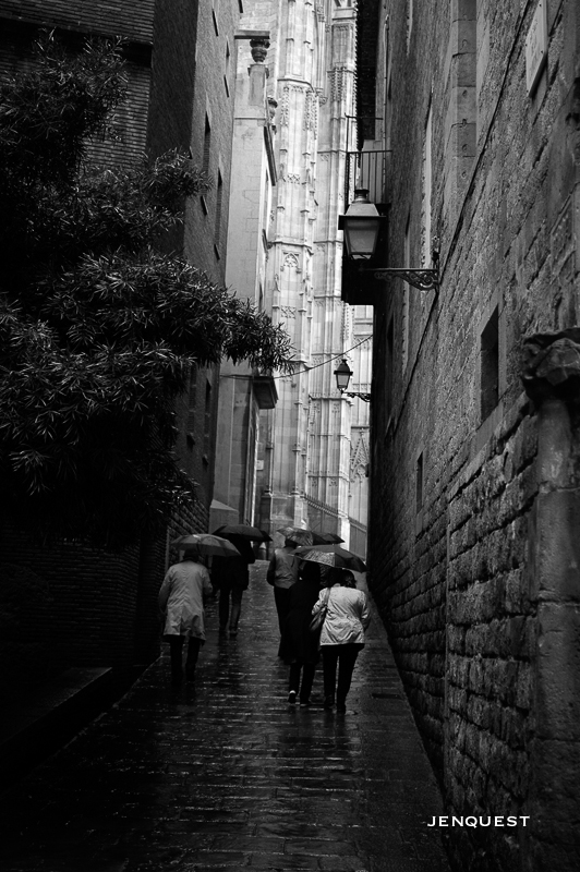 Shelter - People with umbrellas in barcelona